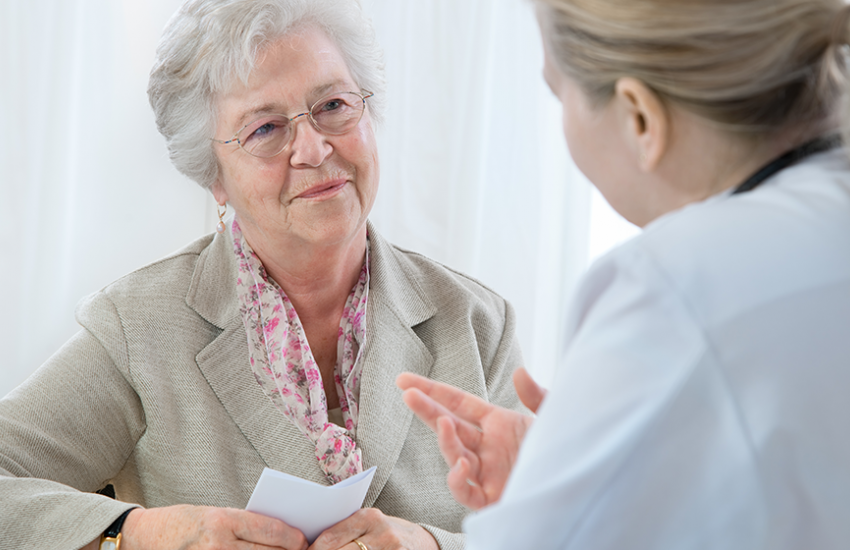 Senior woman speaking with doctor
